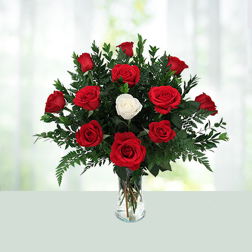 Red & White Roses In Glass Vase