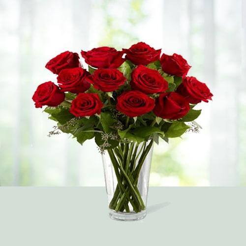 Blomming Roses In a Glass vase