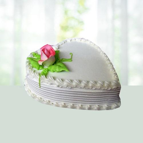 Eggless Heart Shape Pineapple Cake