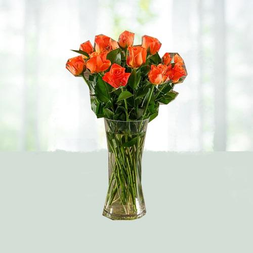 Orange Roses in a Glass Vase