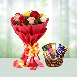 Bunch of roses with assorted chocolates in basket