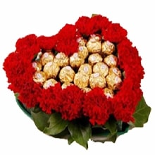 Carnations and Ferrero Heart Shaped Arrangement
